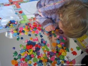 Reggio activities for toddlers using mirrors and buttons 2
