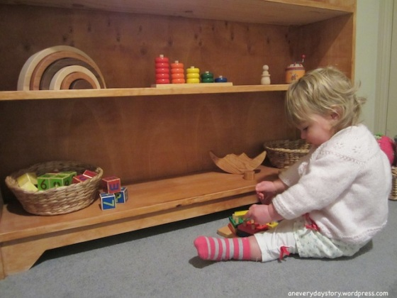 montessori bedroom for toddlers low shelves and toys materials for 18 months old